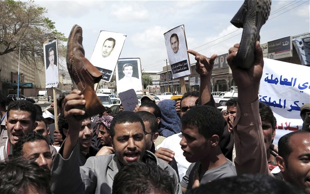 Protesters wave their shoes as they protest against deportation by Saudi Arabia of thousands of Yemeni workers. Photo: Reuters