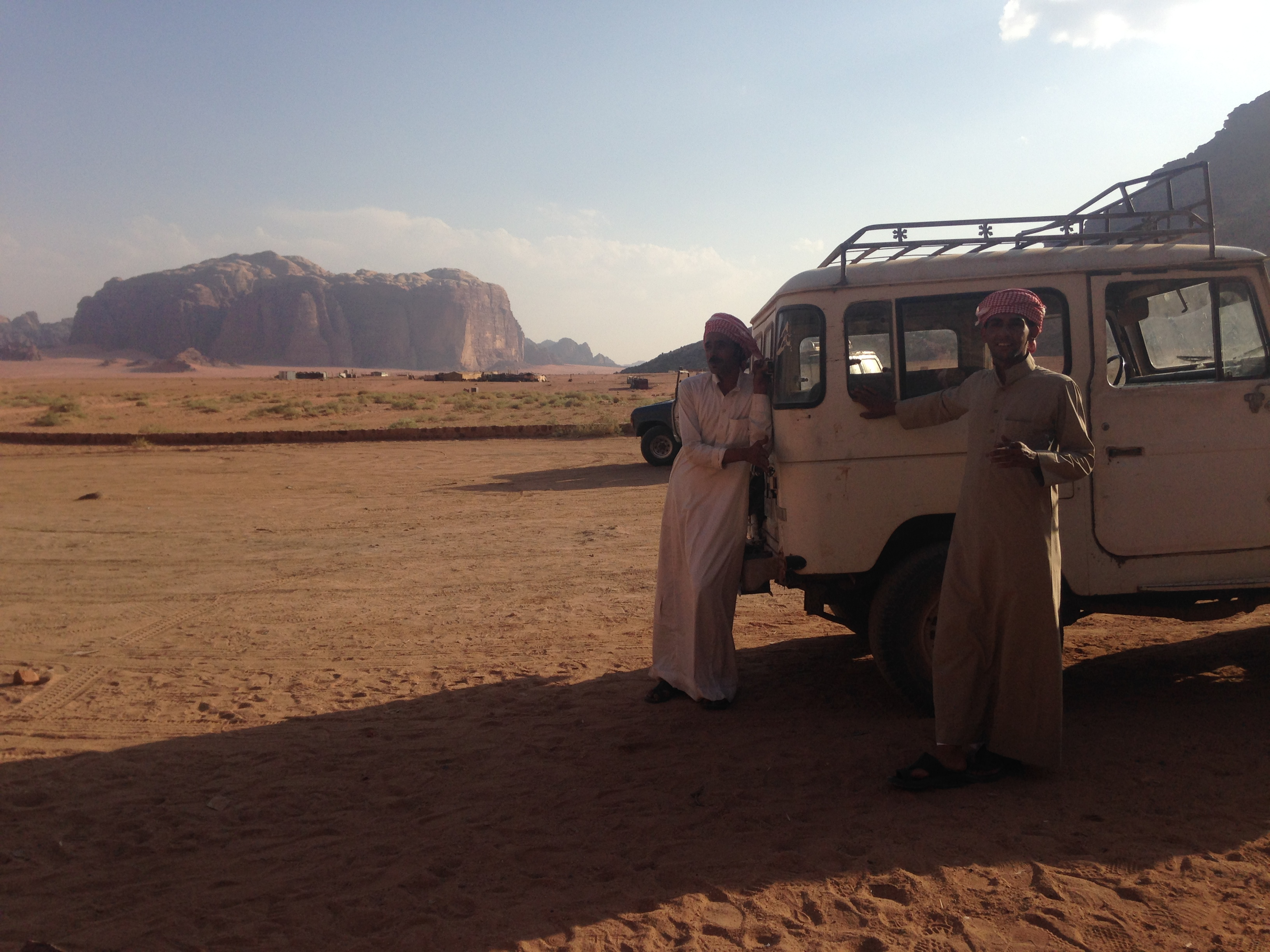 Two Bedouins wearing traditional Bedouin clothes in the Wadi Rum desert. Photo by Camilla Toftlund.