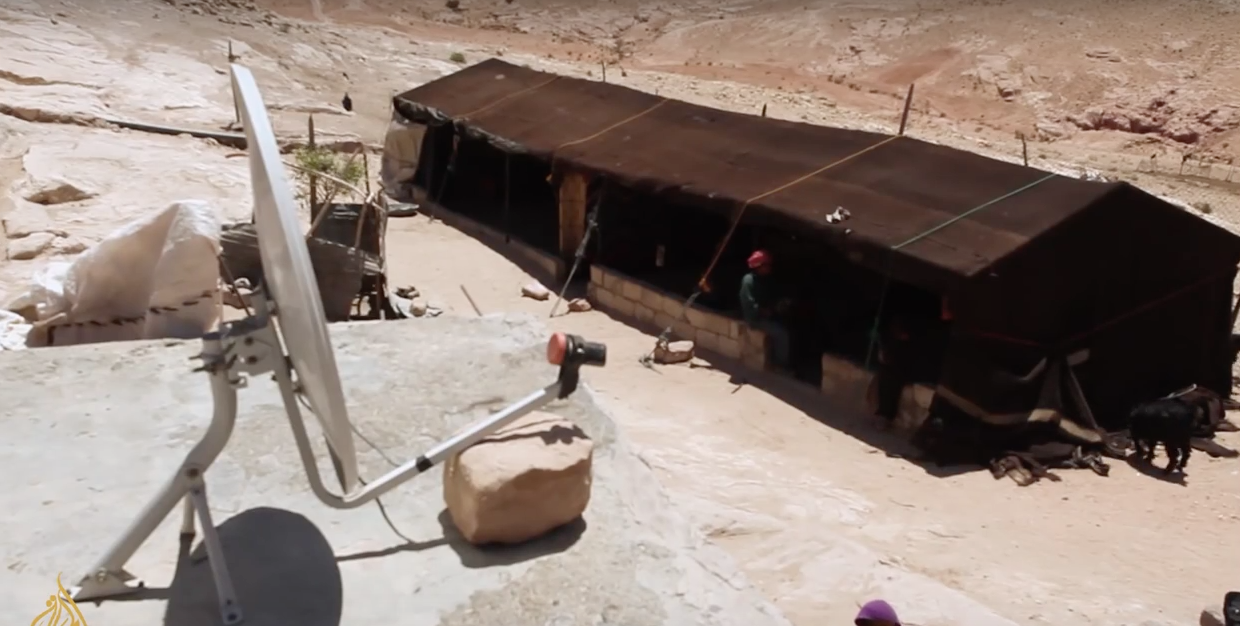 "Even satellite discs can be found in Petra. Screenshot from a video by Al-Jazeera: ""The Bedouin of Petra""."