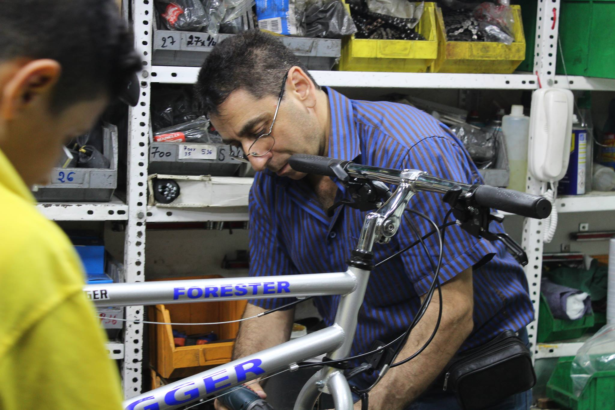 Noubar Korjikian fixing a bike in his shop Cyclosport, in the heart of Beirut. Photo: Anne Kirstine Rønn/The Turban Times