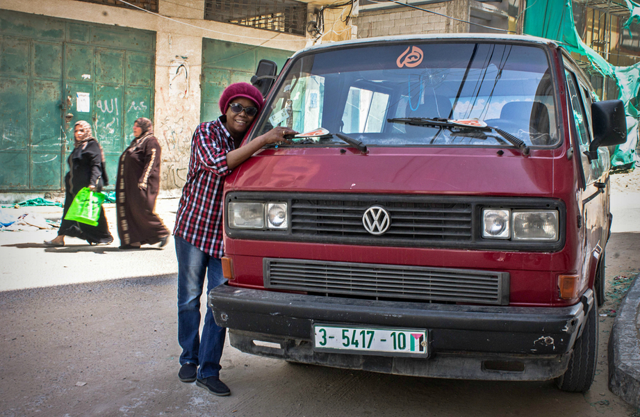 Salwa is posing with her beloved bus in front of her house. Credit: Asmaa Elkhaldi/The Turban Times